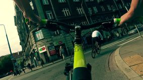 WARSAW, POLAND - JULY 18, 2017. POV shot of a man cycling to work along the street in city center stock video