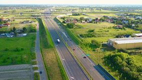 WARSAW, POLAND - JUNE 19, 2017. Aerial shot of modern highway interchange in outskirts of a big city on a summer day. WARSAW, POLAND - JUNE 19, 2017. Aerial shot Royalty Free Stock Images
