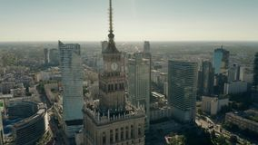 WARSAW, POLAND - JUNE 5, 2019. Aerial shot of the Palace of Culture and Science within city centre skyscrapers stock video footage