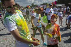 The Color Run Warsaw 2019. WARSAW, POLAND - June 1, 2019. Participants coated in paint celebrate healthiness, peace, individuality at unique colorful 5 km run stock photo