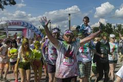 The Color Run Warsaw 2019. WARSAW, POLAND - June 1, 2019. Participants coated in paint celebrate healthiness, peace, individuality at unique colorful 5 km run stock photography