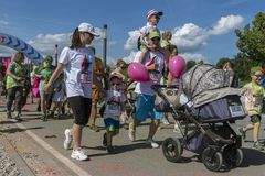 The Color Run Warsaw 2019. WARSAW, POLAND - June 1, 2019. Participants coated in paint celebrate healthiness, peace, individuality at unique colorful 5 km run stock image