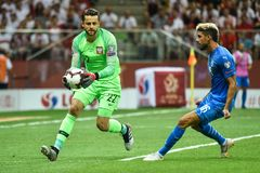 In action goalkeeper Lukasz Fabianski. L and Yonatan Cohen. WARSAW, POLAND - JUNE 10, 2019: Qualifications Euro 2020  match Poland - Israel 4:0. In action stock photo