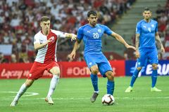 In action Krzysztof Piatek L and Omri Ben Harush. WARSAW, POLAND - JUNE 10, 2019: Qualifications Euro 2020  match Poland - Israel 4:0. In action Krzysztof Piatek royalty free stock images