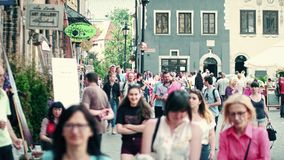 WARSAW, POLAND - JUNE 10, 2017. Tourists walk along old town street on a summer day Stock Photo