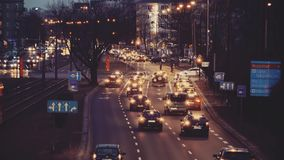 WARSAW, POLAND - MARCH 12, 2018. Cars stop at road intersection. Major city street traffic in the evening. WARSAW, POLAND - MARCH 12, 2018 Cars stop at road stock video footage