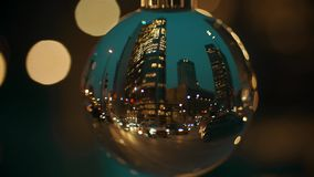 WARSAW, POLAND - MARCH 5, 2018. Downtown street traffic in the evening distorted by the glass ball. WARSAW, POLAND - MARCH 5, 2018. City downtown street stock footage