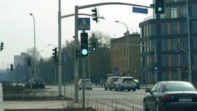 WARSAW, POLAND - MARCH 5, 2018. City street traffic lights at road intersection. WARSAW, POLAND - MARCH 5, 2018 City street traffic lights stock footage