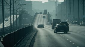 WARSAW, POLAND - MARCH 5, 2018. Major street traffic in city smog. WARSAW, POLAND - MARCH 5 2018 City street traffic stock video footage