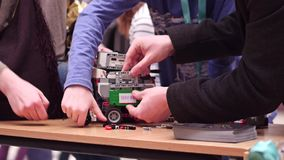 WARSAW, POLAND - MARCH, 4, 2017. DIY robot and family supporting young participant of robotics competition. WARSAW, POLAND - MARCH, 4, 2017. DIY robot and family royalty free stock image