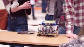 WARSAW, POLAND - MARCH, 4, 2017. DIY robot and young participants of robotics fair Stock Photography