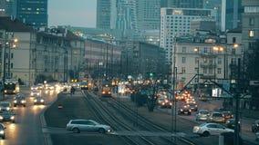 WARSAW, POLAND - MARCH 12, 2018. Major city street traffic in the evening. WARSAW, POLAND - MARCH 12, 2018 Major city street traffic stock video