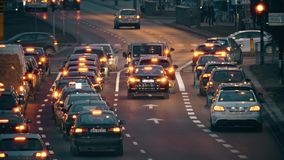 WARSAW, POLAND - MARCH 12, 2018. Major city street traffic at roads intersection in the evening. WARSAW, POLAND - MARCH 5 2018 City street traffic stock video