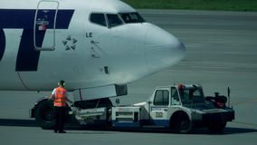 WARSAW, POLAND - MAY, 18, 2017. LOT Boeing 737 airliner being maintained at the airport. Telephoto lens shot Royalty Free Stock Image