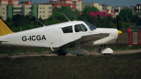 WARSAW, POLAND - MAY, 13, 2017. Telephoto lens shot of Piper PA-28-140 light propeller airplane takeoff Royalty Free Stock Photo