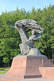 WARSAW, POLAND. A monument to the composer Frederic Chopin against the background of trees Stock Photos