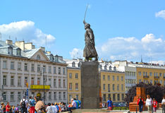 WARSAW, POLAND. A monument to Jan Kilinsky against the background of historical buildings Royalty Free Stock Photo
