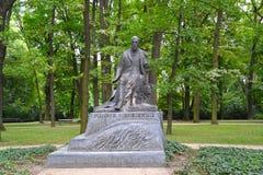 WARSAW, POLAND. A monument to the writer Henryk Sienkiewicz in the Lazenki park Royalty Free Stock Photography