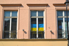 WARSAW, POLAND. National flag of Ukraine in a building window. WARSAW, POLAND - AUGUST 23, 2014: National flag of Ukraine in a building window Royalty Free Stock Image