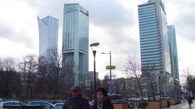 WARSAW, POLAND - NOVEMBER, 27, 2016. Business district tall modern office buildings 4K steadicam shot stock video footage