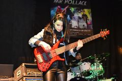 Bass player Joanna Dudkowska, free concert of Mr. Pollack rock band, Warsaw, 2017-11-11. WARSAW, POLAND - NOVEMBER 11, 2017: Free concert of Mr. Pollack rock royalty free stock image