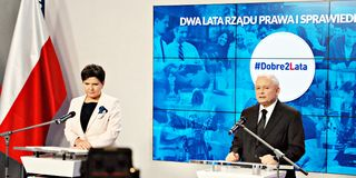 Leader of ruling party Law and Justice, Kaczynski, right, and Polish Prime Minister Szydlo attend a press conference summarizing t Royalty Free Stock Photo