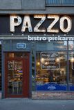 Front facade of the street cafe `Pazzo` in Warsaw. The letters are decorated with lamps. royalty free stock image