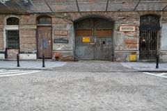 WARSAW, POLAND. The old building with signs of of workshops on a facade stock photography