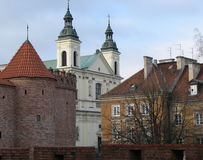 Warsaw, Poland - old town. The Old Town in Warsaw - the Polish capital. A UNESCO world heritage site. City walls, tower and Church of the Holy Spirit stock photos