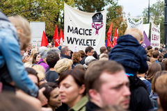Warsaw, Poland, 2016 10 01 - protest against anti-abortion law f. Orced by Polish government; crowd with banner saying: Cursed wombs (reference to Cursed royalty free stock photography