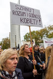 Warsaw, Poland, 2016 10 01 - protest against anti-abortion law f. Orced by Polish government; woman with banner saying: Respect intellect and the dignity of royalty free stock photography