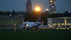 WARSAW, POLAND - SEPTEMBER 14, 2017. LOT Polish airlines commercial airplane taxiing at the airport at night Royalty Free Stock Photography