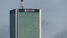WARSAW, POLAND - SEPTEMBER 8, 2017. Marriott Hotel high-rise building telephoto lens shot. WARSAW, POLAND - SEPTEMBER 8 2017 Marriott Hotel stock image