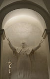 WARSAW, POLAND. A statue of the Pope John Paul II in a niche of a cathedral church of the Sacred Cross. WARSAW, POLAND - AUGUST 23, 2014: A statue of the Pope royalty free stock photo