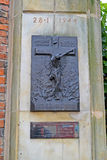 WARSAW, POLAND. A stele with a crucifixion. A memorial to the dead during the Warsaw revolt on January 28, 1944 Royalty Free Stock Photography