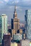 Warsaw / Poland - 03.16.2017: Vertical view at mixed modern and old architecture. Contrast view at the old architecture building  Palace of Culture and Science Stock Images