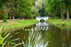 WARSAW, POLAND. A view of the channel with the Chinese small lamps ashore in the Lazenki park stock photography