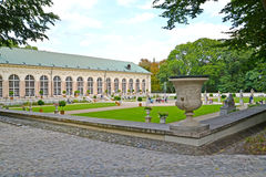WARSAW, POLAND. A view of a garden and the building of the Old greenhouse in the Lazenki park Stock Photo