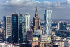 Warsaw / Poland - 03.16.2017: View at mixied modern and old architecture. Contrast view at the old architecture building  Palace of Culture and Science and Stock Images