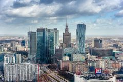 Warsaw / Poland - 03.16.2017: View at mixied modern and old architecture. Contrast view at the old architecture building  Palace of Culture and Science and Stock Photos