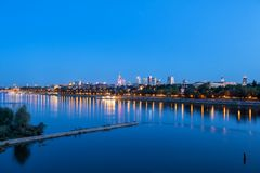 Warsaw River View In The Evening. City skyline of Warsaw in the evening, view across the Vistula River, capital of Poland stock images