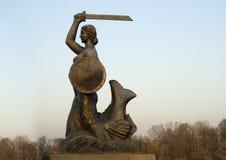 Warsaw shield siren statue. Siren warsaw shied statue on Vistula river side Stock Photo