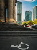 Warsaw skyscrapers. Stairs to Palace of Culture and Science. Skyscrapers in background. Invalid sign on the ground. Poland, Warsaw stock photography