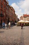 Warsaw - Square of the Old Town. Poland,Warsaw.Square of Old Town.Photo taken in May 2007.One can see café gardens with umbrellas ,many tourists and historic Royalty Free Stock Image