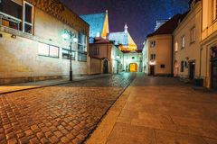 Warsaw at starry night. Empty street illuminated with streetlamp under sky full of bright stars. Warsaw capital of Poland stock images