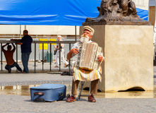 Warsaw. Street musician. Royalty Free Stock Image
