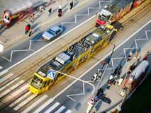 Warsaw tram collecting passengers on tram stop. Warsaw light rail at tram stop. People are waiting for public transport. View from above Stock Image