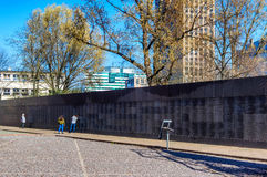 Warsaw Uprising Museum. Memorial Wall with the names of thousands of insurgents who were killed during the Uprising - Warsaw, Poland Stock Image