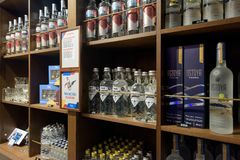 Warsaw Vodka Museum. Warsaw, Poland - Oct 20, 2018: Different types of Vodkas for sale in the Warsaw Vodka Museum royalty free stock image