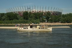 Warsaw is warsaw is changing. Spring in warsaw on river  vistula old ship and national stadion is background Stock Photos